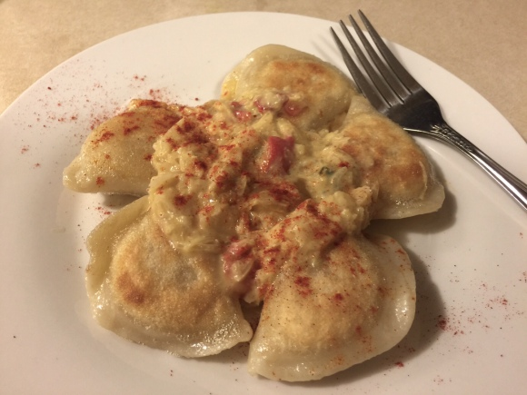 FRIED POTATO PIEROGI WITH CREAMED SAUERKRAUT